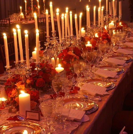 The wonderful effect of candle light, flowers and up lighting with a beautiful fall wedding.  The...