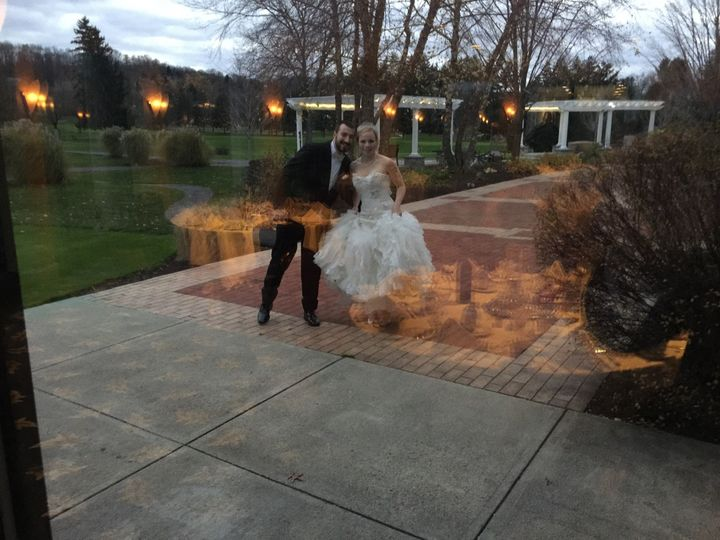 The bride and groom enjoying a romantic moment outside under the moonlight to the perfect music with...