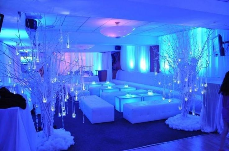 Elegant winter wedding event with ice blue shadow up lighting and led crystal lighting on the tables...