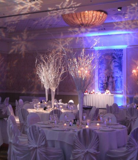 Amazing winter wedding scene with snow flake images projected on the ceiling and walls combined with...