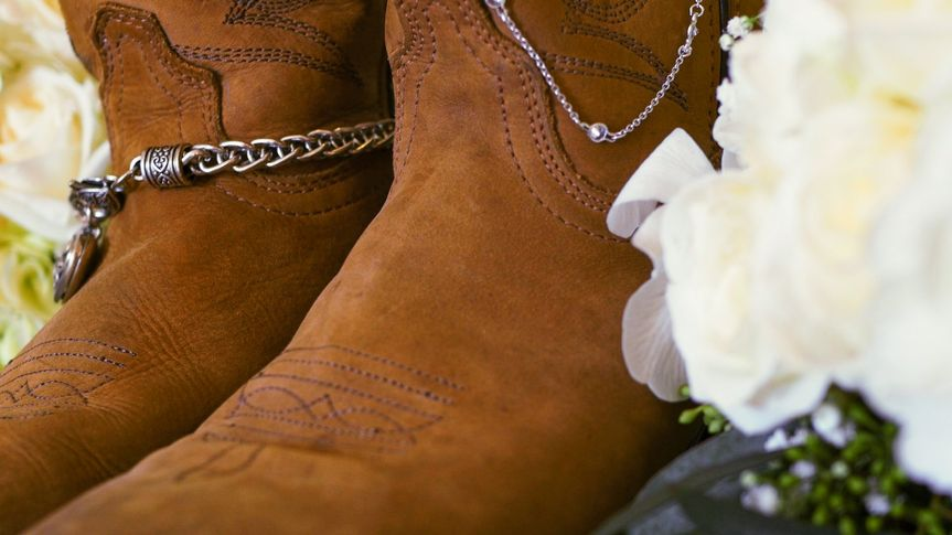 Bridal boots and a bouquet.