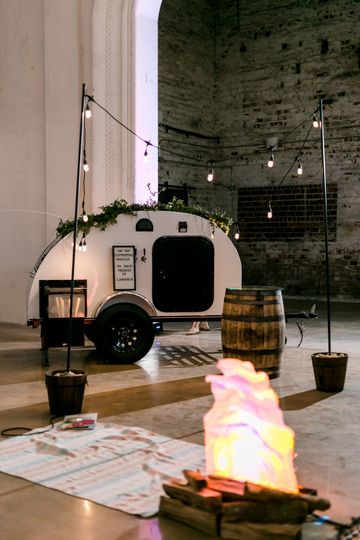 Camper beside lantern