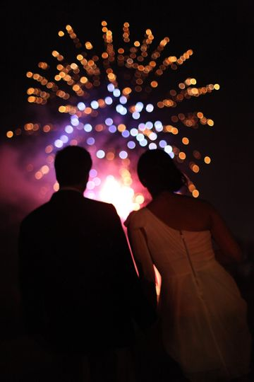 Couple watching fireworks display