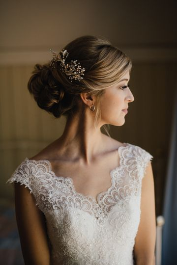 Bridal updo with floral notes