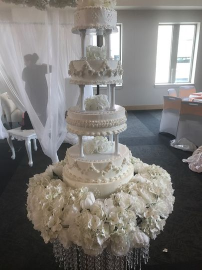 5 tier pillared w/ floral bed