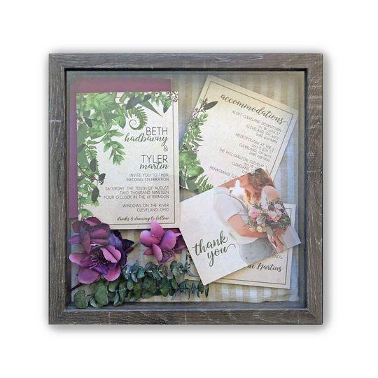 Rustic wedding invitations on wood grain