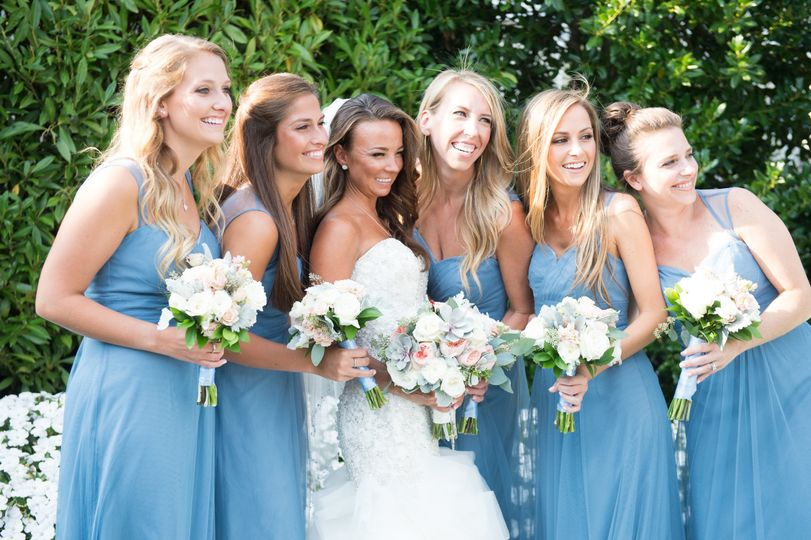 The bride with her bridesmaids in blue dresses