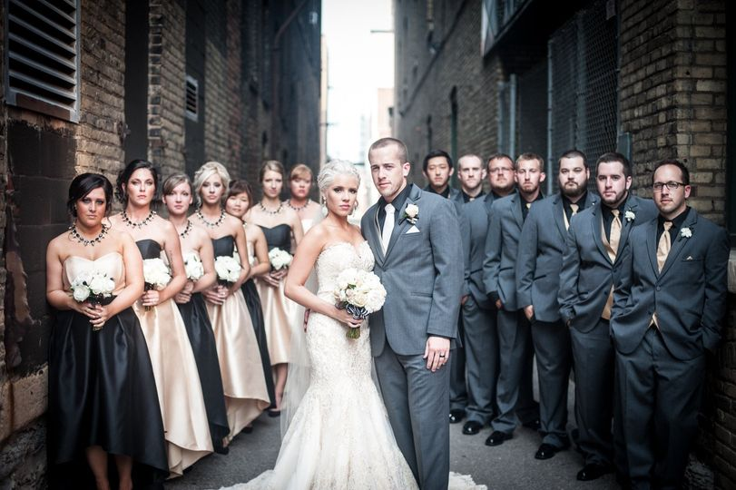 This entire bridal party was dressed by Bella Bridal Boutique. A beautiful Allure Couture bridal...
