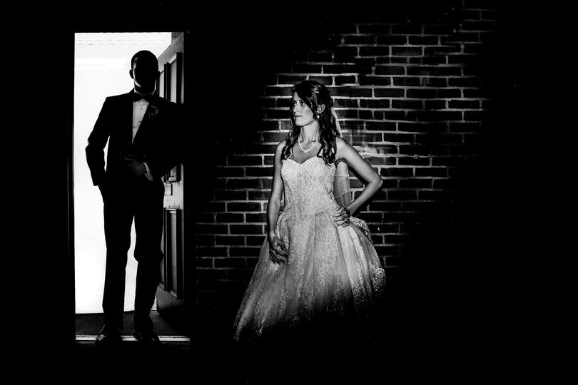 moody bw photo of a bride and groom