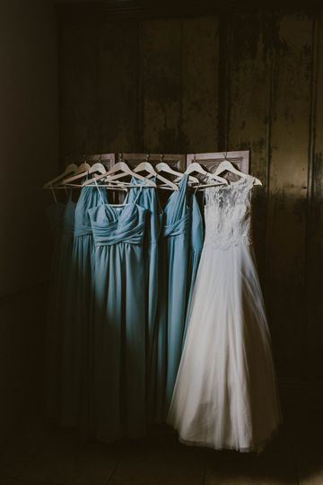 Detail shot of Kelsey's wedding gown and her bridesmaids.