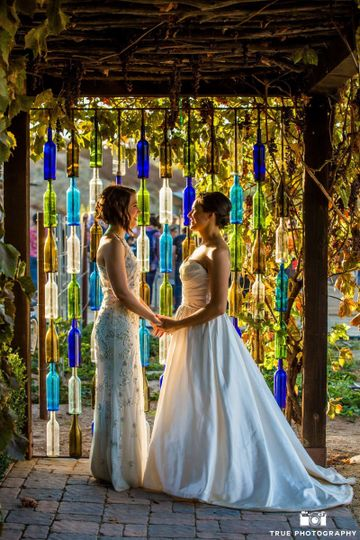Colorful arch with 2 brides