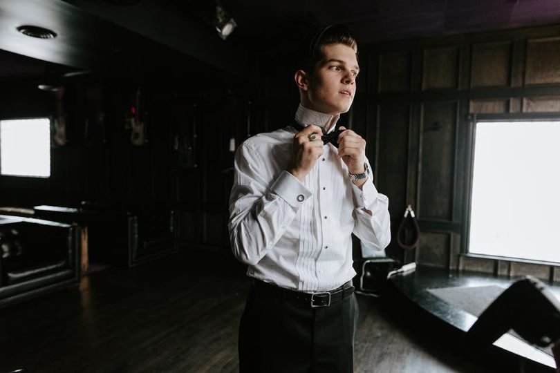 Putting on a bow tie