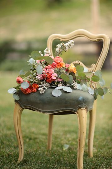 Queen Anne chair in blue velvet with a bridal bouquet,