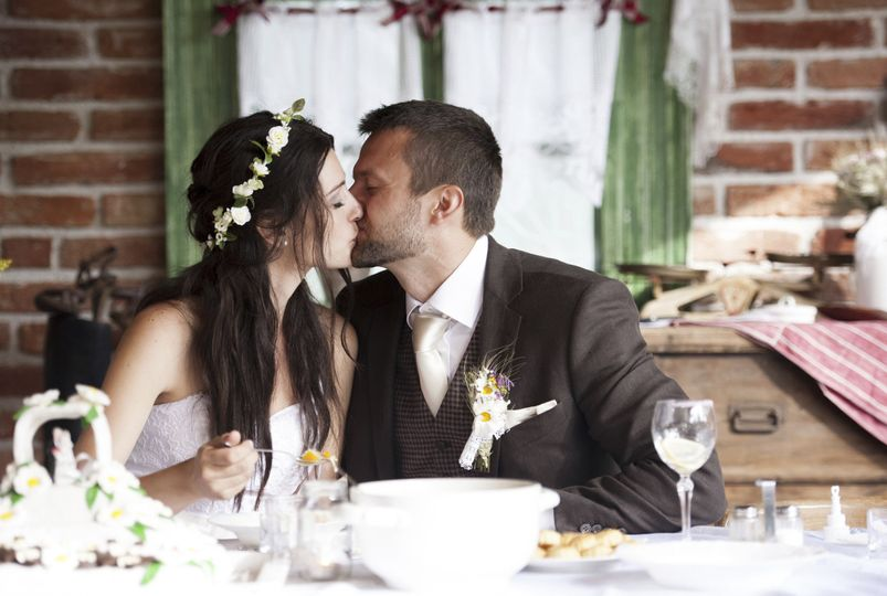 bride groom eating with a kiss