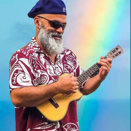 Ukulele with rainbow backdrop
