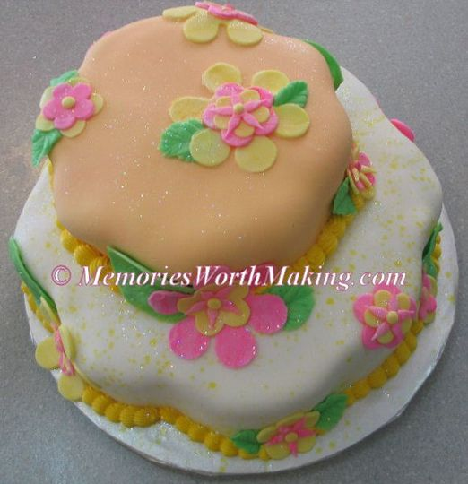 Luau 2-tier fondant covered cake created for a second wedding.  To see more of the best cakes in...