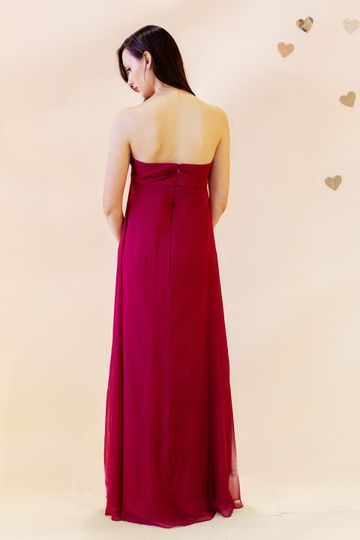 Bisou  Strapless empire waist gown with rose detail at center of bust.  Available in multiple...