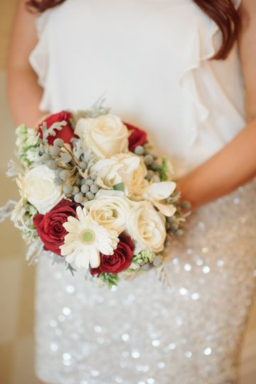 Bridal bouquet with white and red roses, gerber daisies, stock, silver brunia and dusty miller.