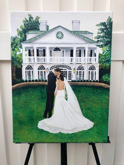 Couple with venue backdrop