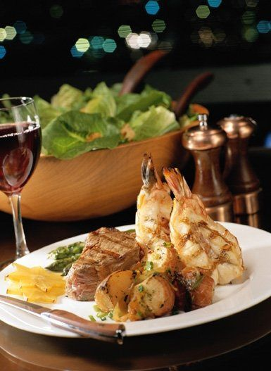 grilled jumbo shrimp with chicken breast and vegetables