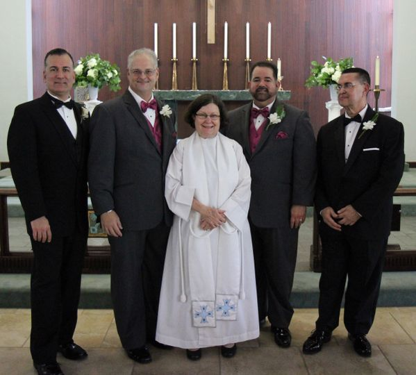 The Rector with the grooms & best men. Photo by Robin Lawrie.