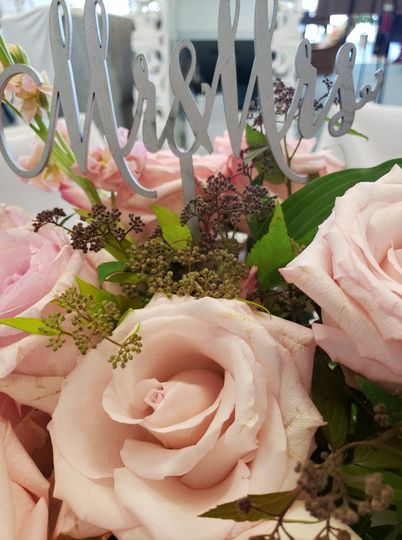 Blush roses and a silver sign