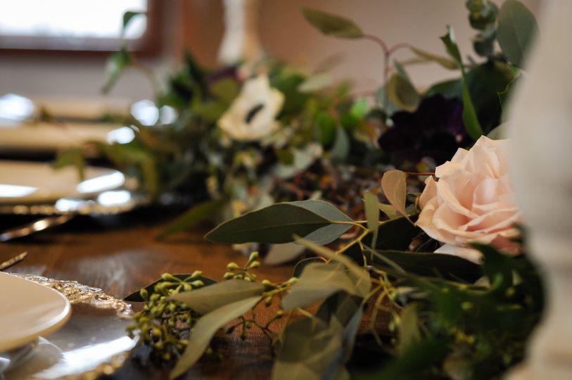 Vintage chargers on farm table