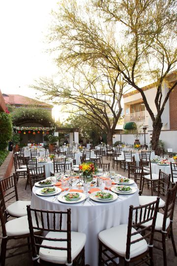 Wedding reception set outside in the sunshine