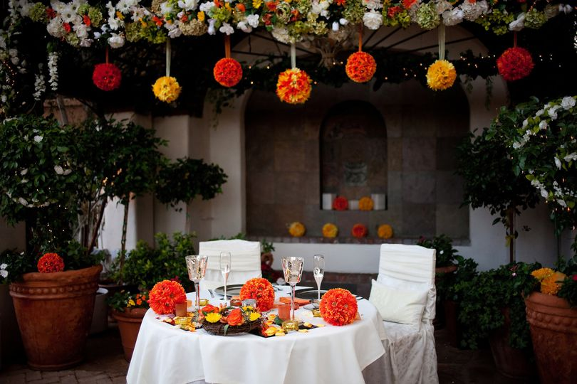 Sweetheart table with yellow and orange decor