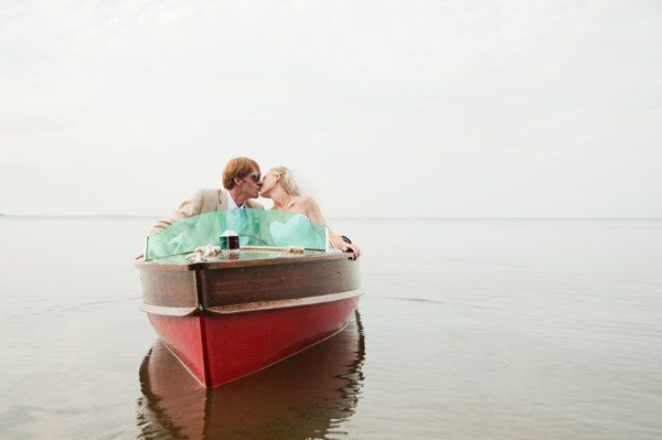 norther minnesota wedding with bride and groom on a boat