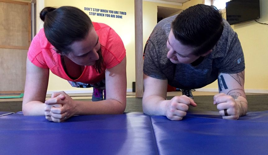 The happy couple keeping each other motivated through the workout. The couple that exercises...