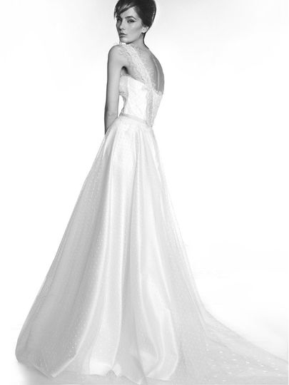 A Victoria KyriaKides, Parisian style dress with a New York airy sprinkling. This gown is made of...
