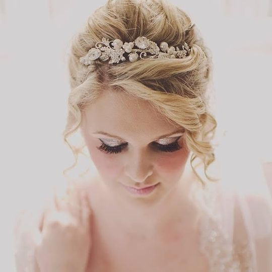 Updo with floral hair ornament