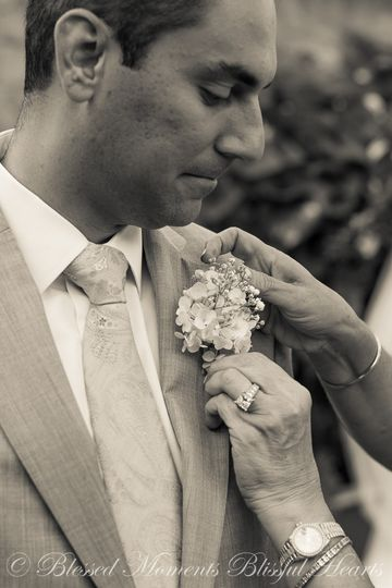 Putting on boutonniere