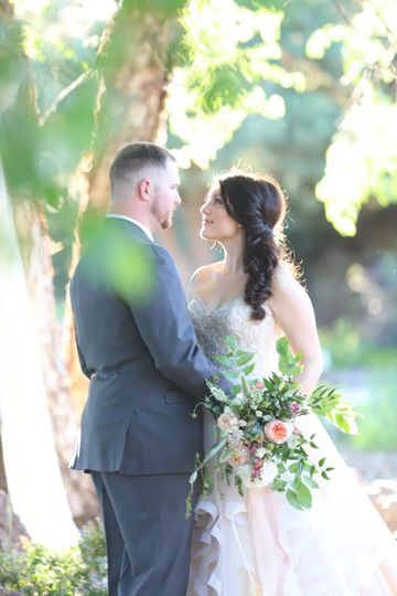 Ceremony by the treesCredit: Kimberlee Miller Photography