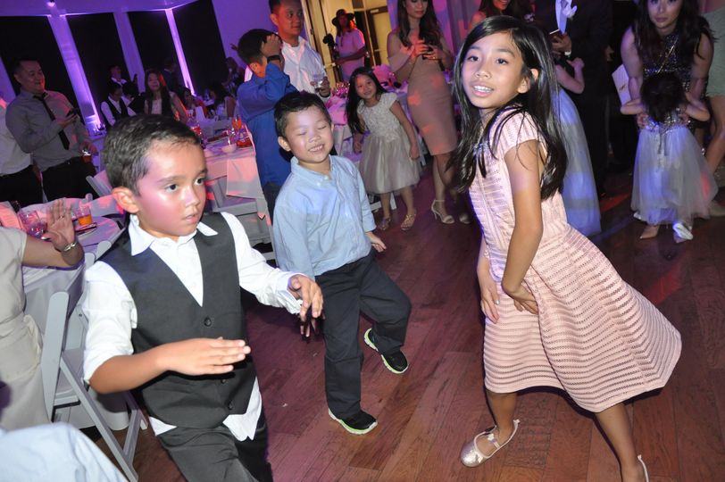 Kids having a blast at wedding