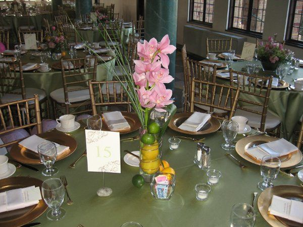 Three styles of centerpiece were used to adorn the tables at this outstanding reception. Shown is a...