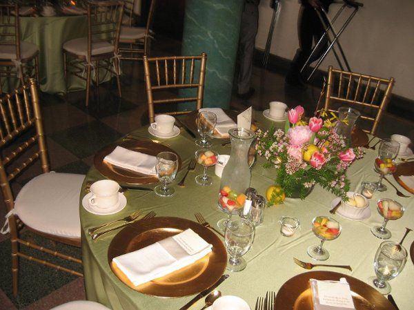 Lemons and limes scattered on the tables, along with flower petals enlarge the impact of the...