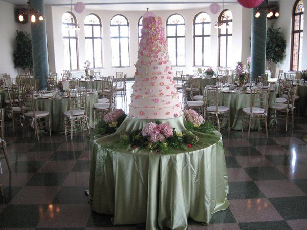 What a magnificent cake. The cascade of edible flowers created by the baker perfectly matched the...