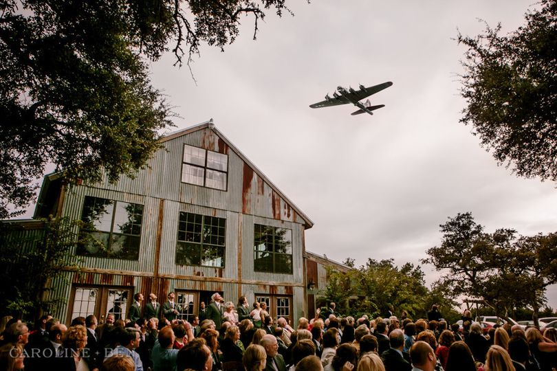 Outdoor wedding ceremony with airplane fly over