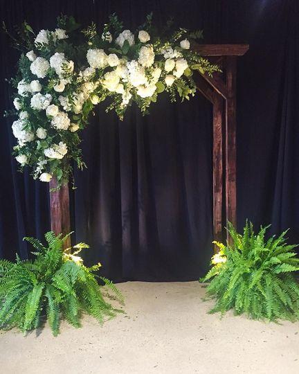 Arbor ceremony florals