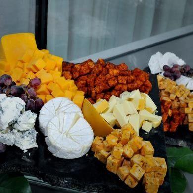 Grande Cheese Platter, an elegant assortment of Sharp Cheddar, Smoked Gouda, Havarti, Brie, Swiss,...