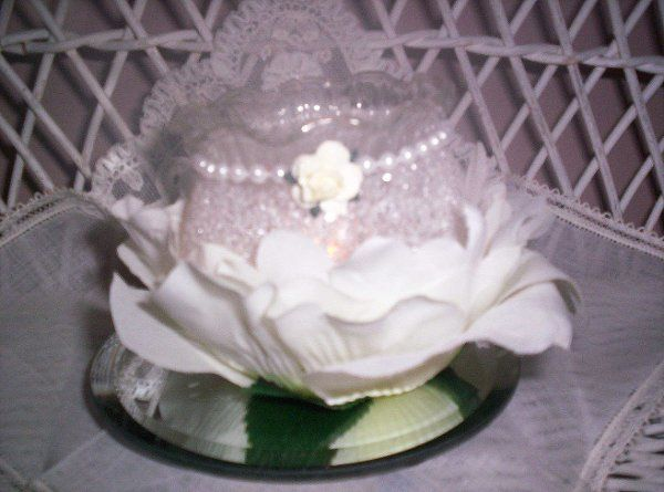 "3"" x 3"" fluted-edge container nestled in white rose petals with pearls and matching miniature rose..."