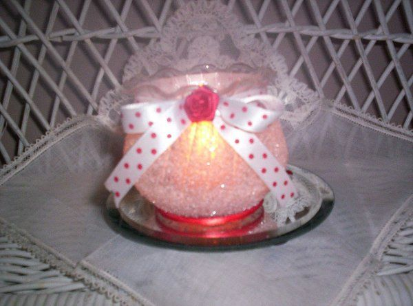 """3"""" x 3"""" fluted-edge container with a red polka-dot ribbon and matching mini-red rose center."""