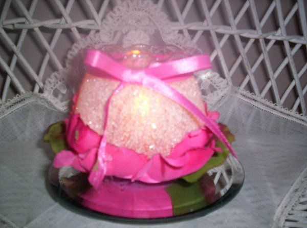 """3"""" x 3""""fluted-edge container nestled in  dark pink Cabbage rose petals and a matching hand-tied..."""