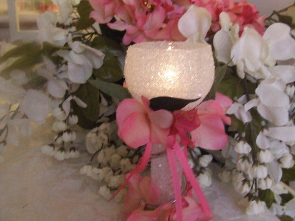 6' wire-wrapped globe-shaped candle holder nestled in pink Orchid petals and matching hand-tied...