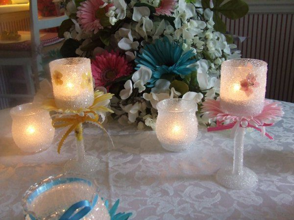 """6 1/2"""" """"Champagne""""-style candle holder with Gerbera daisies and matching hand-tied ribbons. This is..."""
