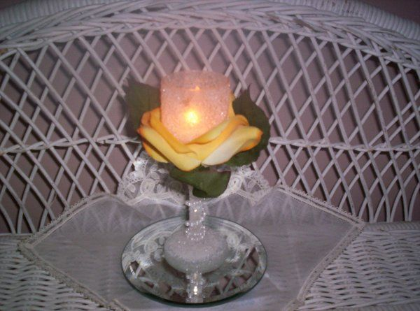 """6 1/2"""" """"Champagne""""-style container nestled in yellow rose petals.  The stem is wrapped in tiny..."""