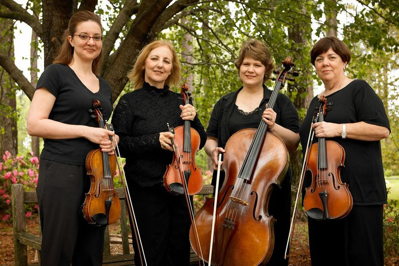 Four Seasons String Quartet prepared to perform for another wedding at the American Rose Center in...