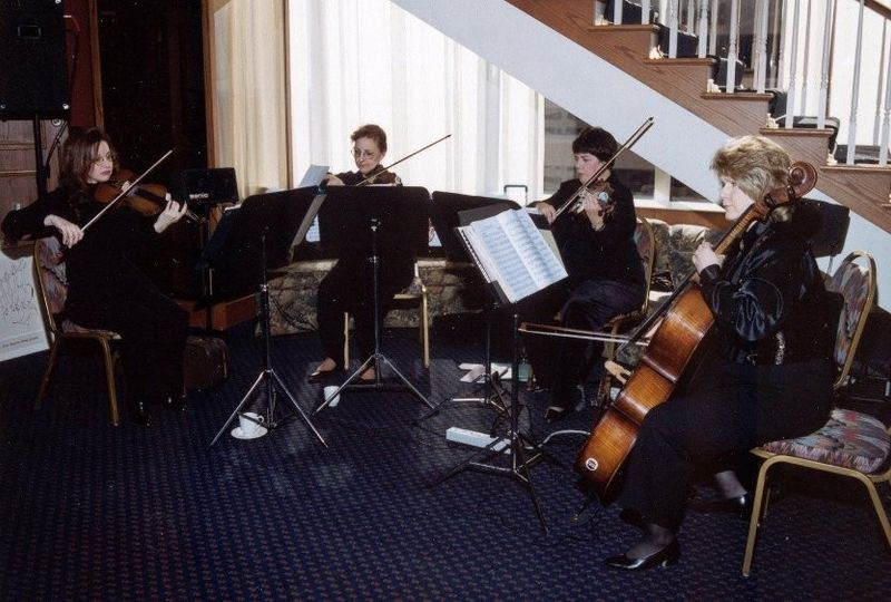 Four Seasons String Quartet performing for guests at the Petroleum Club of Shreveport